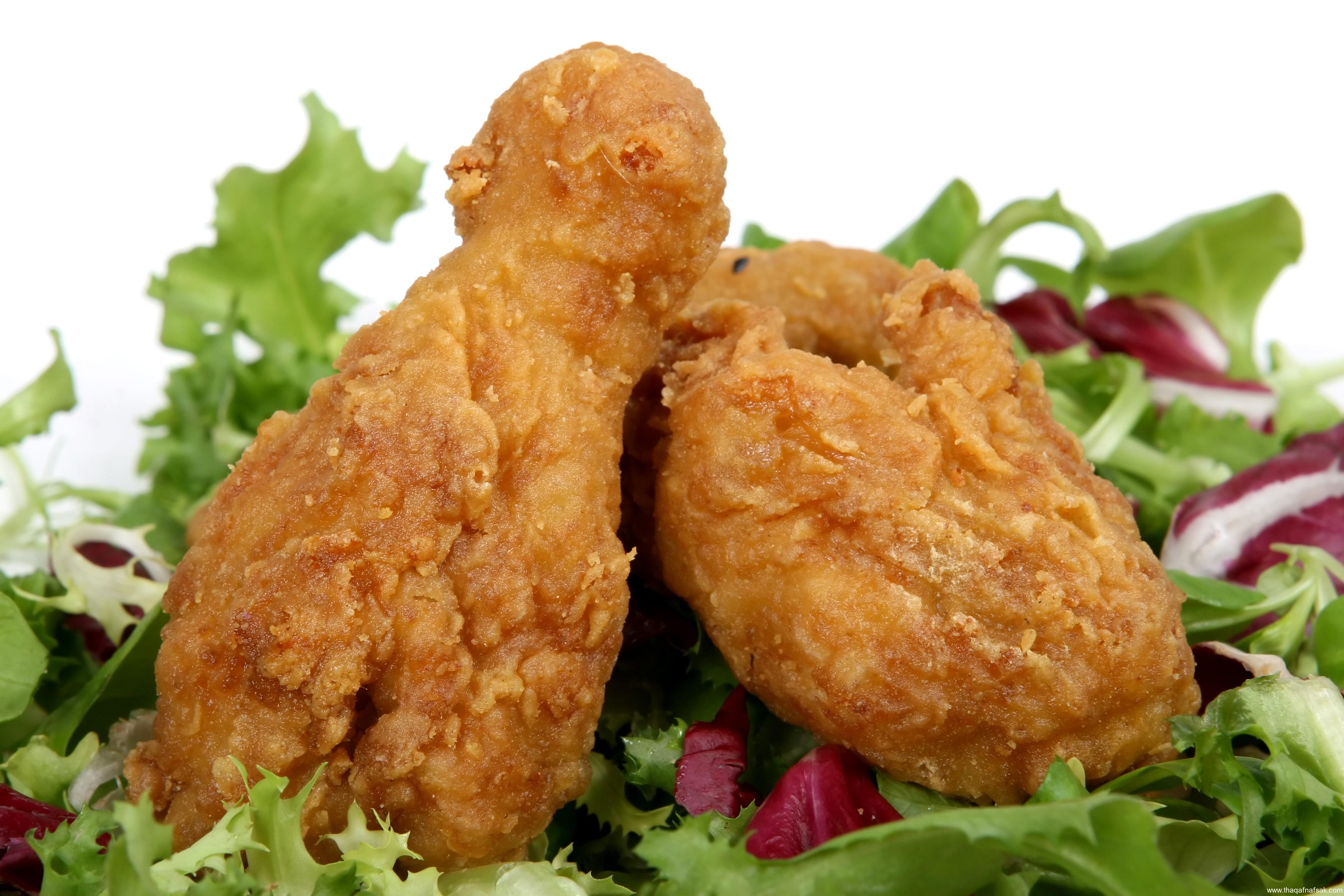 Deep fried spring chicken in golden lemon batter with salad